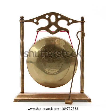 Isolated brass chinese gong on white background - stock photo