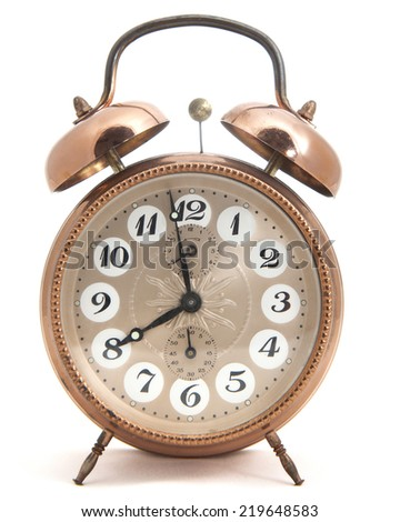 Isolated brass made classic clock - stock photo