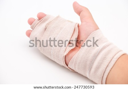 Isolated broken or splint hand with band aid cloth for medical on white background - stock photo
