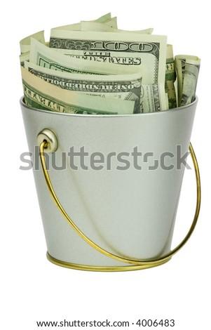 Isolated bucket of money over white background - stock photo