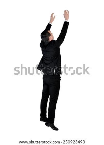 Isolated business man climb something - stock photo