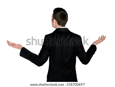 Isolated business man confused looking back - stock photo
