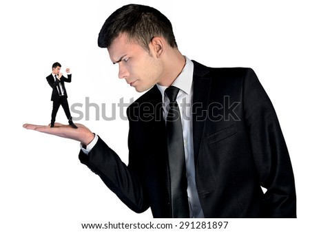 Isolated business man looking angry on little man - stock photo