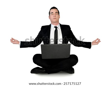 Isolated business man meditation with laptop - stock photo