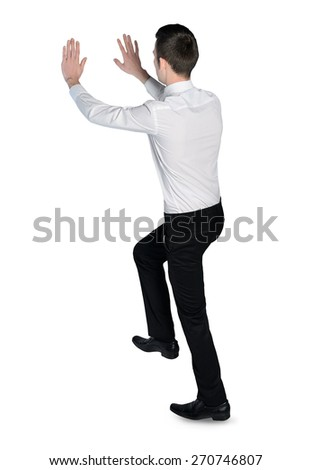 Isolated business man push something - stock photo