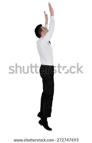 Isolated business man reach something - stock photo