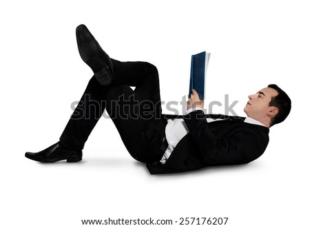Isolated business man reading book - stock photo