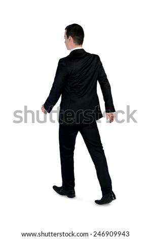 Isolated business man walk away - stock photo
