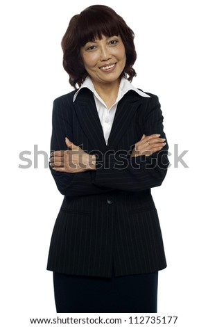 Isolated Business manager posing with her arms crossed against white background - stock photo
