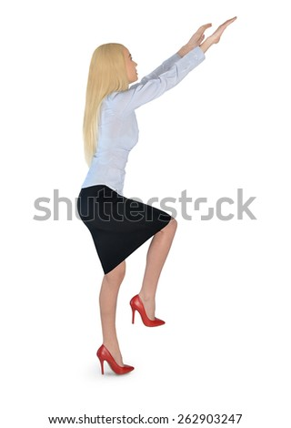 Isolated business woman climb something - stock photo