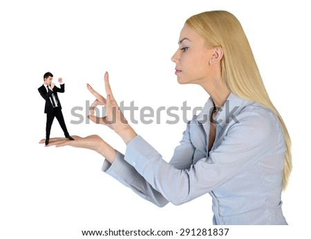 Isolated business woman finger flipping on little man - stock photo