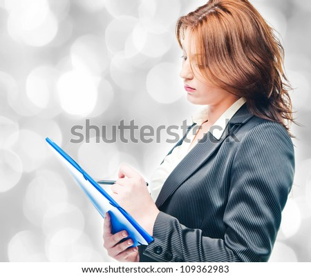 isolated business woman holding a portfolio - stock photo