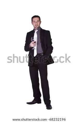 Isolated businessman celebrating with a glass of drink - stock photo