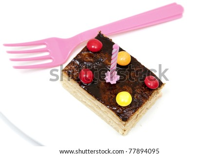 isolated cake with a pink fork - stock photo