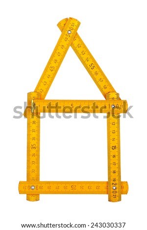 isolated carpenter's ruler shaped as a house - stock photo