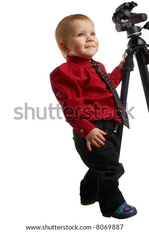 Isolated child in a tie keeping for a tripod - stock photo