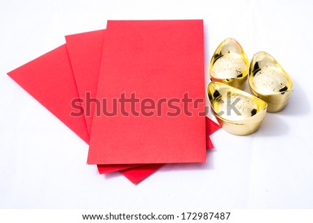 Isolated Chinese red pockets and ancient Chinese gold ingots for Chinese new year decoration - stock photo