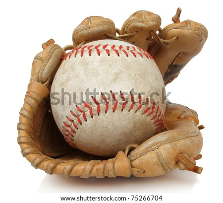 Isolated close up of a worn softball and vintage baseball glove - stock photo