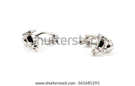 Isolated close up of cufflinks motorbike over white - stock photo