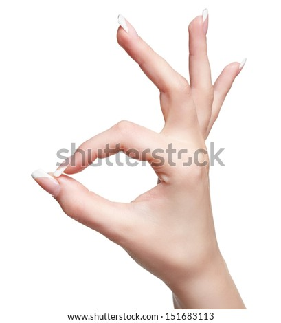 isolated close-up shot of young woman's healthy hand showing ok gesture - stock photo