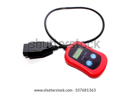 Isolated closeup of a red and black diagnostic car tester. - stock photo
