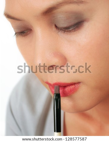 Isolated closeup on the face of an asian middle age woman - stock photo