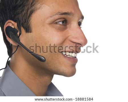 Isolated closeup studio shot of a businessman talking on a telephone headset. - stock photo