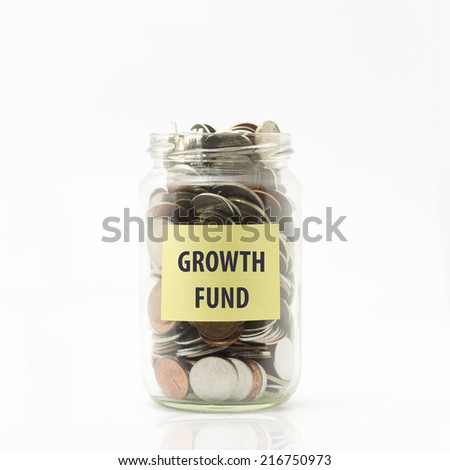 Isolated coins in jar with growth fund label - financial concept - stock photo
