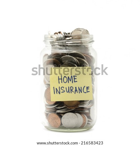 Isolated coins in jar with home insurance label - financial concept - stock photo