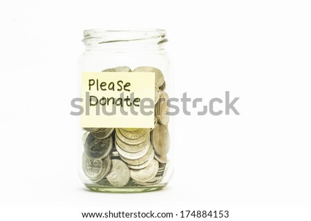 Isolated coins in jar with Please donate label - stock photo