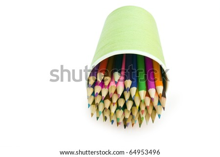 isolated color pencils are in the glass on a white backround - stock photo