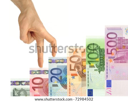 Isolated concept shot of a hand climbing up banknotes arranged as stairs - stock photo