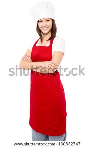 Isolated  confident young baker woman over white background. - stock photo