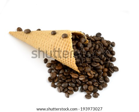 isolated cornet with coffe beans on white background - stock photo