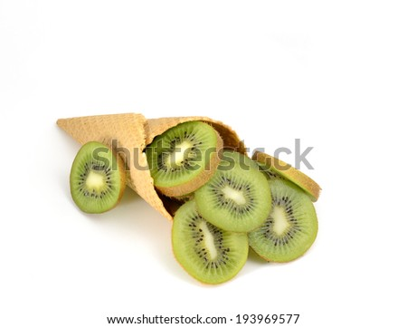 isolated cornet with fresh kiwi on white background - stock photo