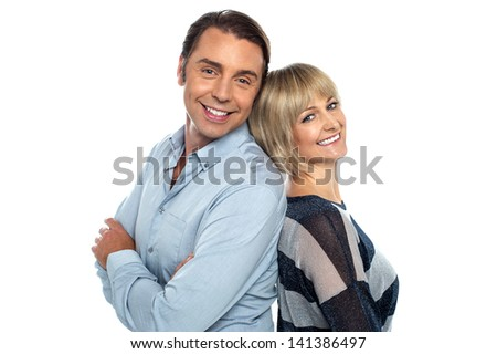 Isolated couple leaning against each other - stock photo