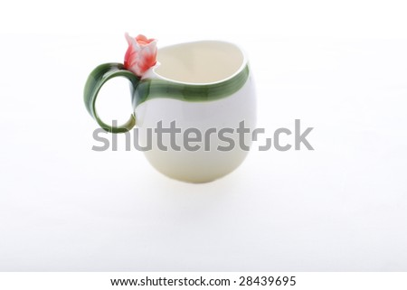 Isolated cup decorated with red flower and green stripe - stock photo