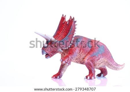 Isolated dinosaur model on white background - stock photo