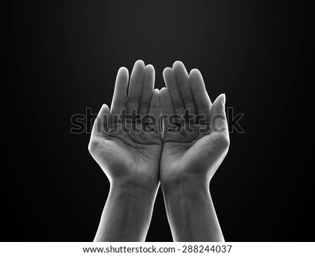 Isolated female empty open human hands with palms raised up in black and white : Pray for spiritual support and helping concept   - stock photo