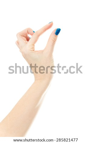 Isolated female hand holding an object or pinch to zoom gesture - stock photo