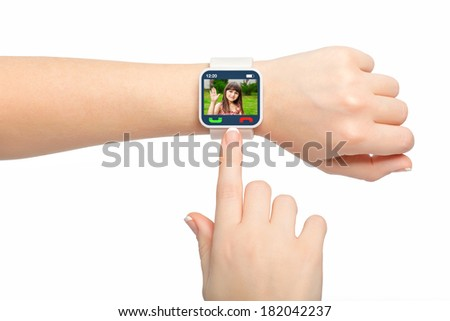 Isolated female hands with white smartwatch with video call on the screen - stock photo
