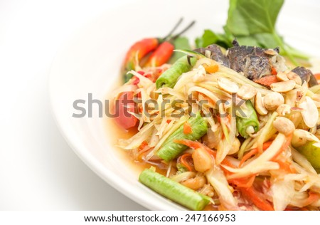 Isolated fresh and green thai papaya salad with hot and spicy taste for food background - stock photo