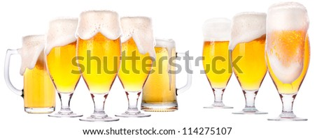 isolated  Frosty glass of beer set on a white background - stock photo
