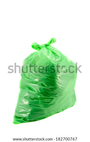 isolated full green garbage plastic bag in white background. Rubbish sack - stock photo