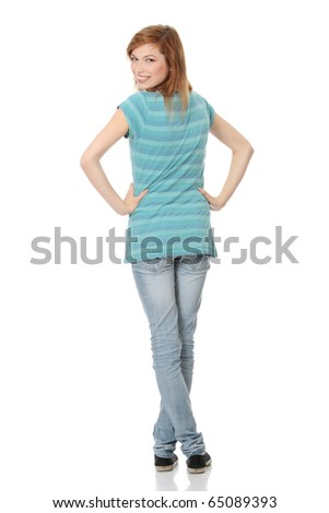 Isolated full length portrait of a beautiful teen woman. - stock photo