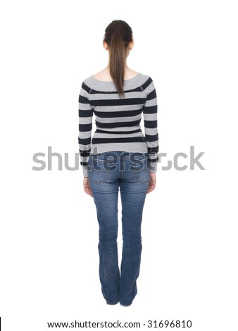 Isolated full length rear view studio shot of a casually dressed young adult woman looking away from the camera. - stock photo