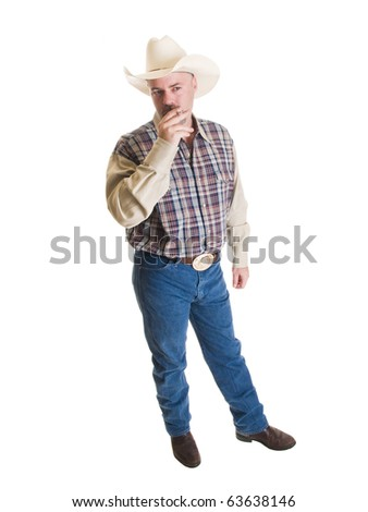 Isolated full length stock photo of a cowboy taking a drag on a cigarette. - stock photo