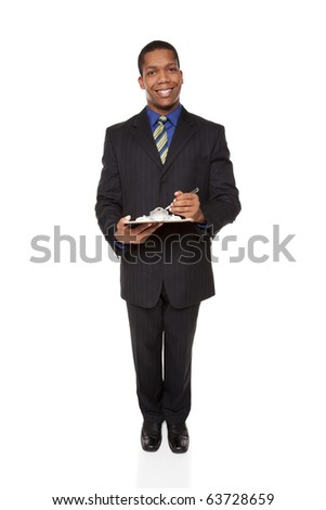 Isolated full length studio shot of a businessman filling out a questionnaire on a clipboard. - stock photo