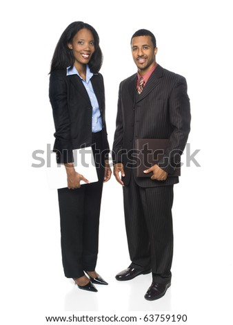 Isolated full length studio shot of a businesswoman and businessman smiling at the camera and holding a computer and organizer. - stock photo