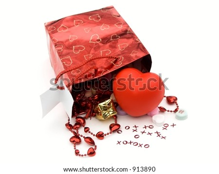 isolated gift bag and presents  with xoxo and hearts,shallow dof - stock photo